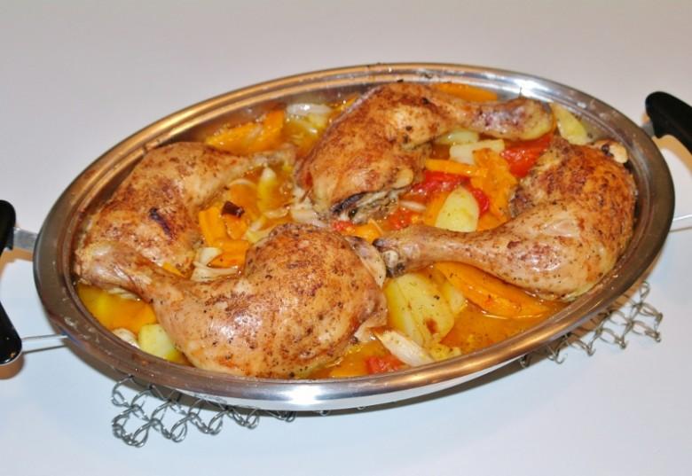 geschmorte-hendlkeulen-mit-tomaten-kuerbis-und-kartoffeln.jpg